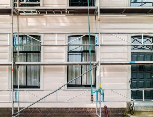 Restoration and painting of an ancient Dutch wooden house in North Amsterdam